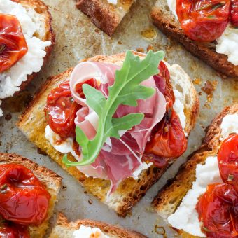 Bruschetta with Rosemary, Roasted Tomatoes, Ricotta, and Prosciutto