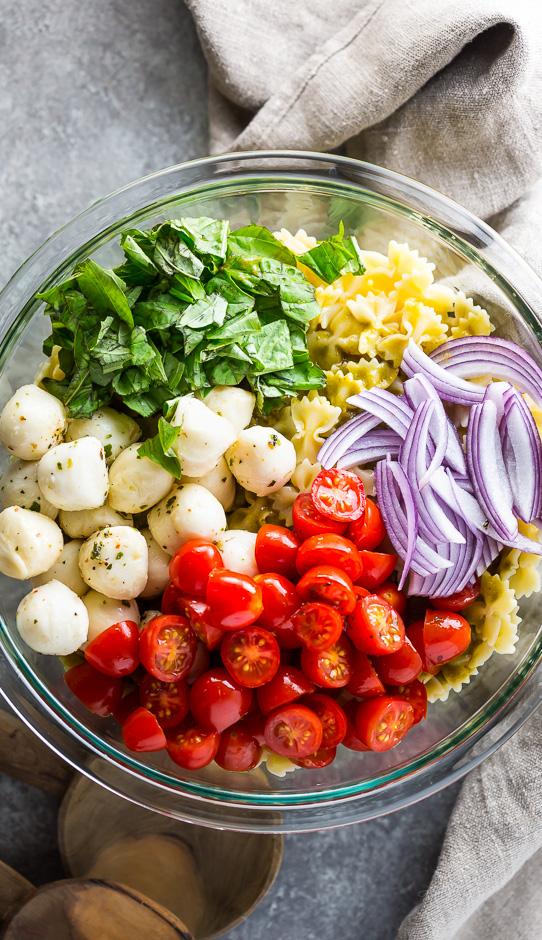 Pasta Salad Ingredients in glass bowl.