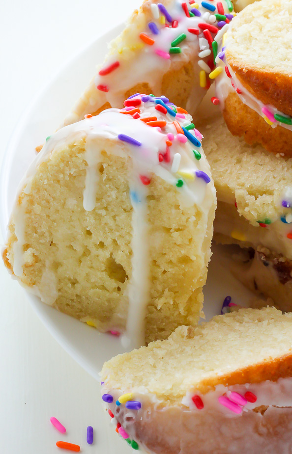 A supremely moist Vanilla Buttermilk Bundt Cake topped with a simple Vanilla Glaze and plenty of sprinkles!
