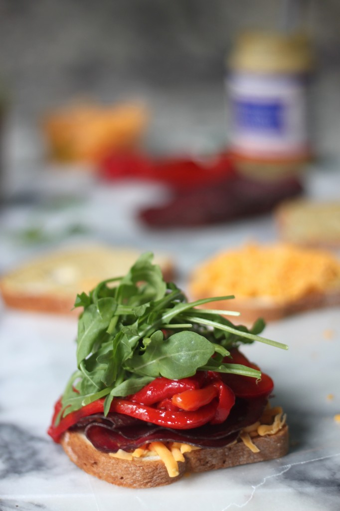 Bresaola, Arugula, and Roasted Red Pepper Cheddar Melts