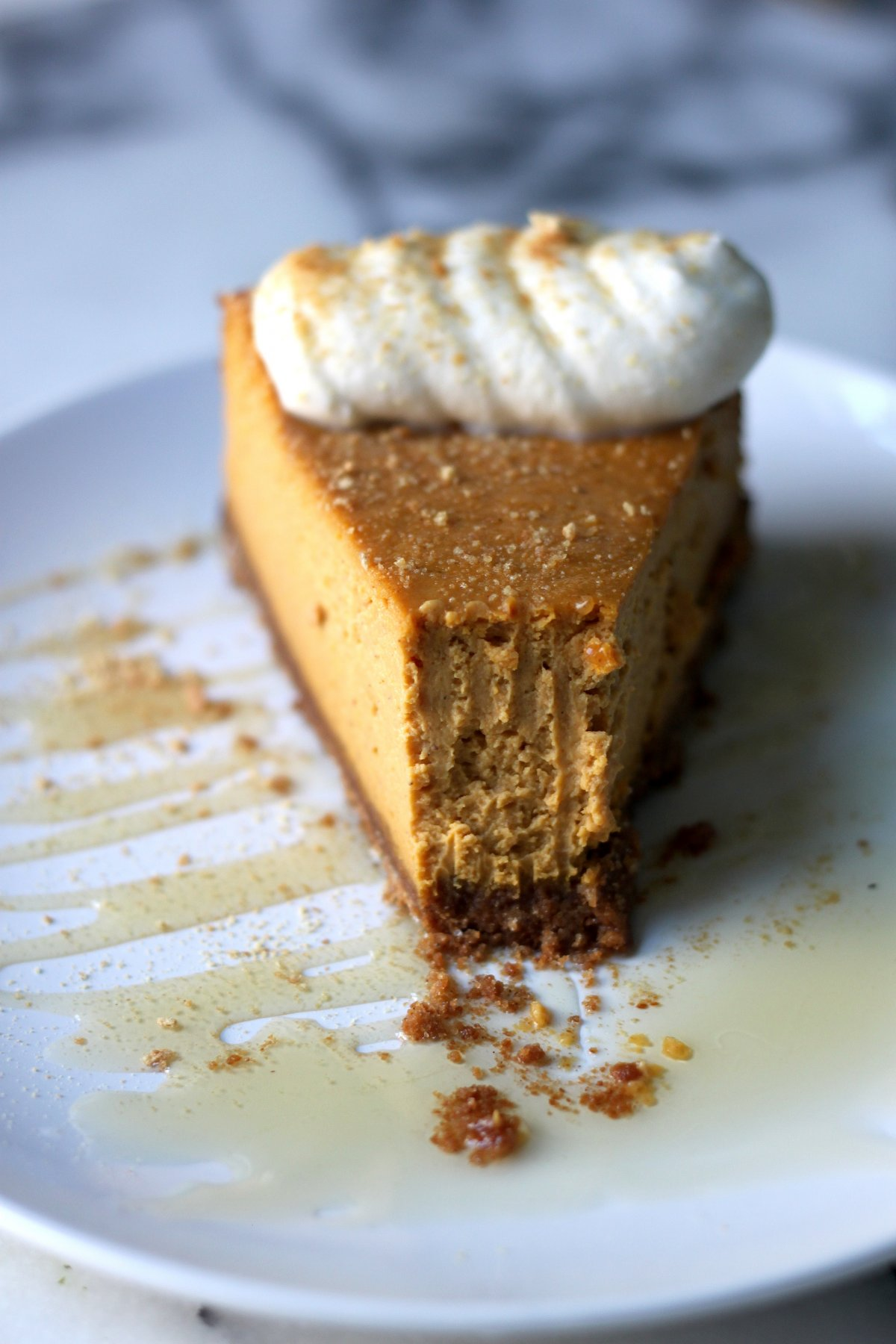 Pumpkin Ricotta Cheesecake with Brown Butter Crust and Grand Marnier Whipped Cream