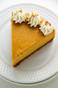 Pumpkin Ricotta Cheesecake with Brown Butter Crust and Grand Marnier Whipped Cream - we make this every Fall!!! So amazing.