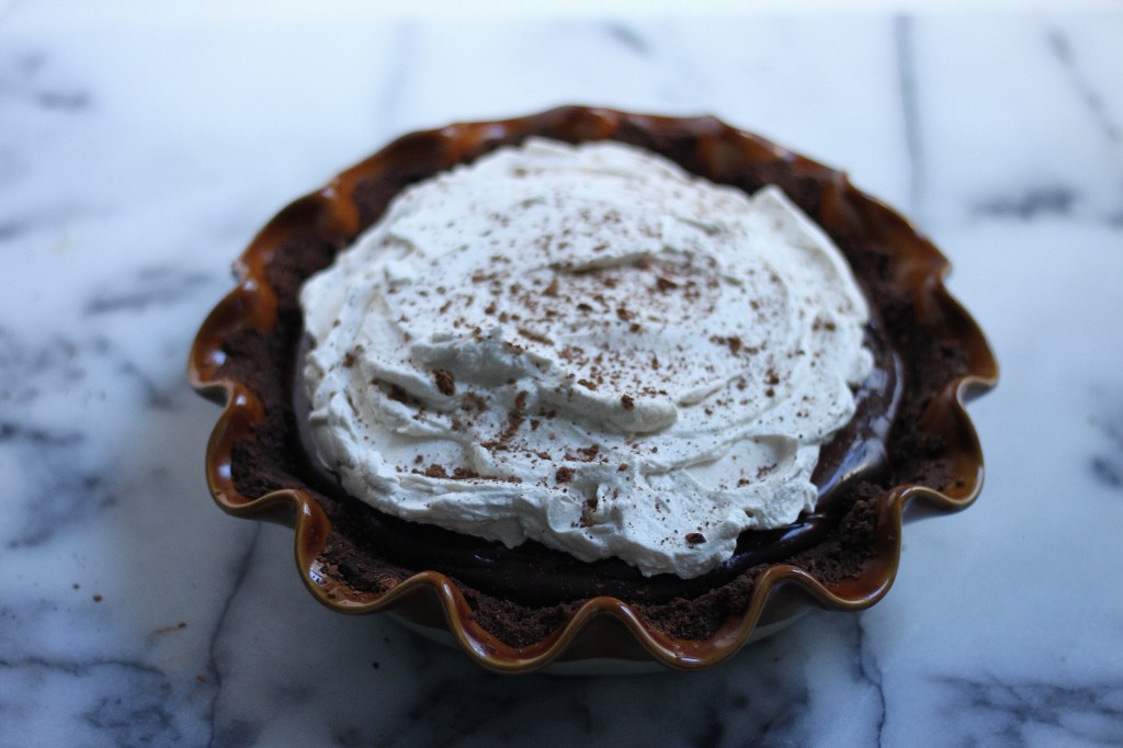 Malted Chocolate Pudding Pie with Chocolate Animal Cracker Crust and Kahlua Whipped Cream