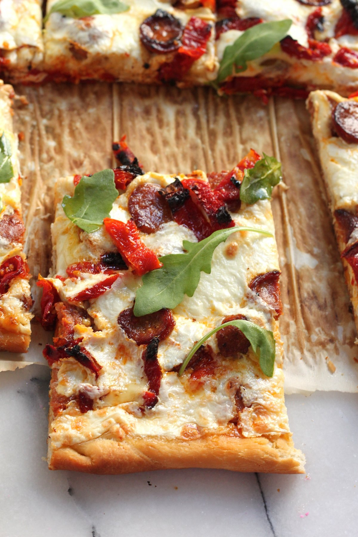Spicy Sausage, Sun Dried Tomato, and Arugula Pizza - Baker by Nature