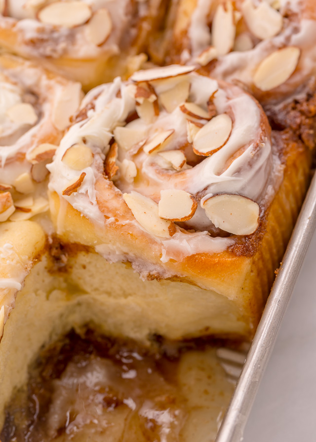 Triple Almond Cinnamon Rolls are the ultimate breakfast treat! This indulgent recipe features soft and fluffy yeasted buns that are filled with brown sugar cinnamon filling and topped with a sticky sweet glaze and slivered almonds! This homemade almond cinnamon roll recipe is a MUST for all of the almond lovers out there!