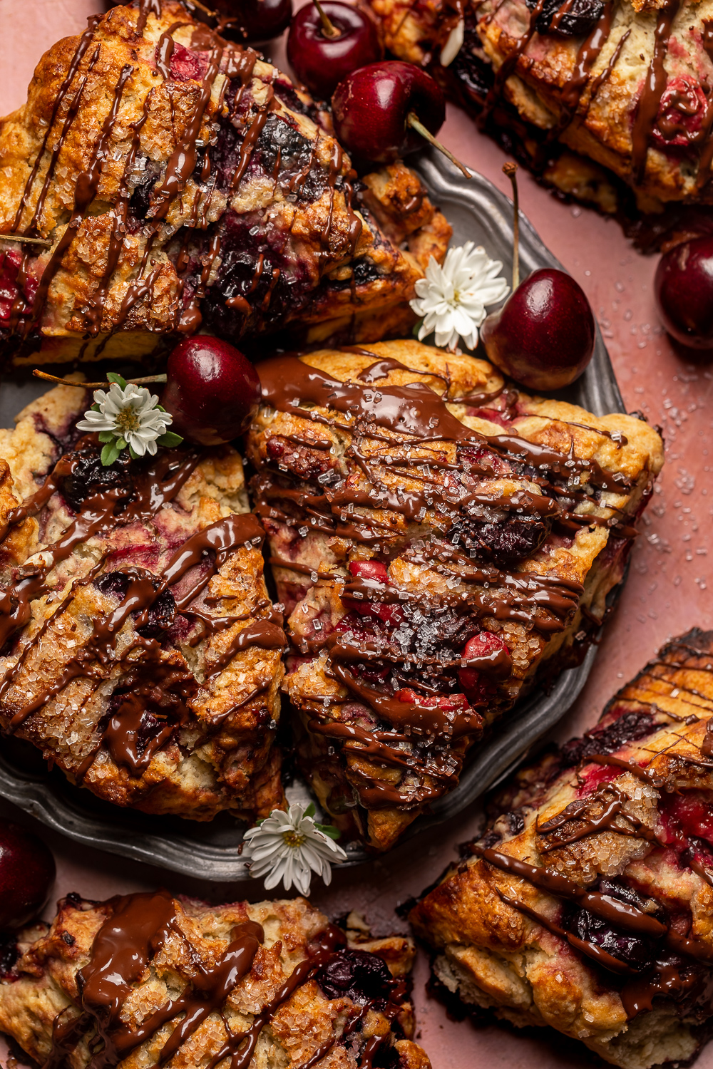 Golden brown, loaded with juicy cherries, and drizzled with dark chocolate, these Chocolate Covered Cherry Scones are a total showstopper! Perfect for breakfast or brunch and so good with a cup of coffee! For an extra chocolate kick, add a 1/2 cup of mini chocolate chips!