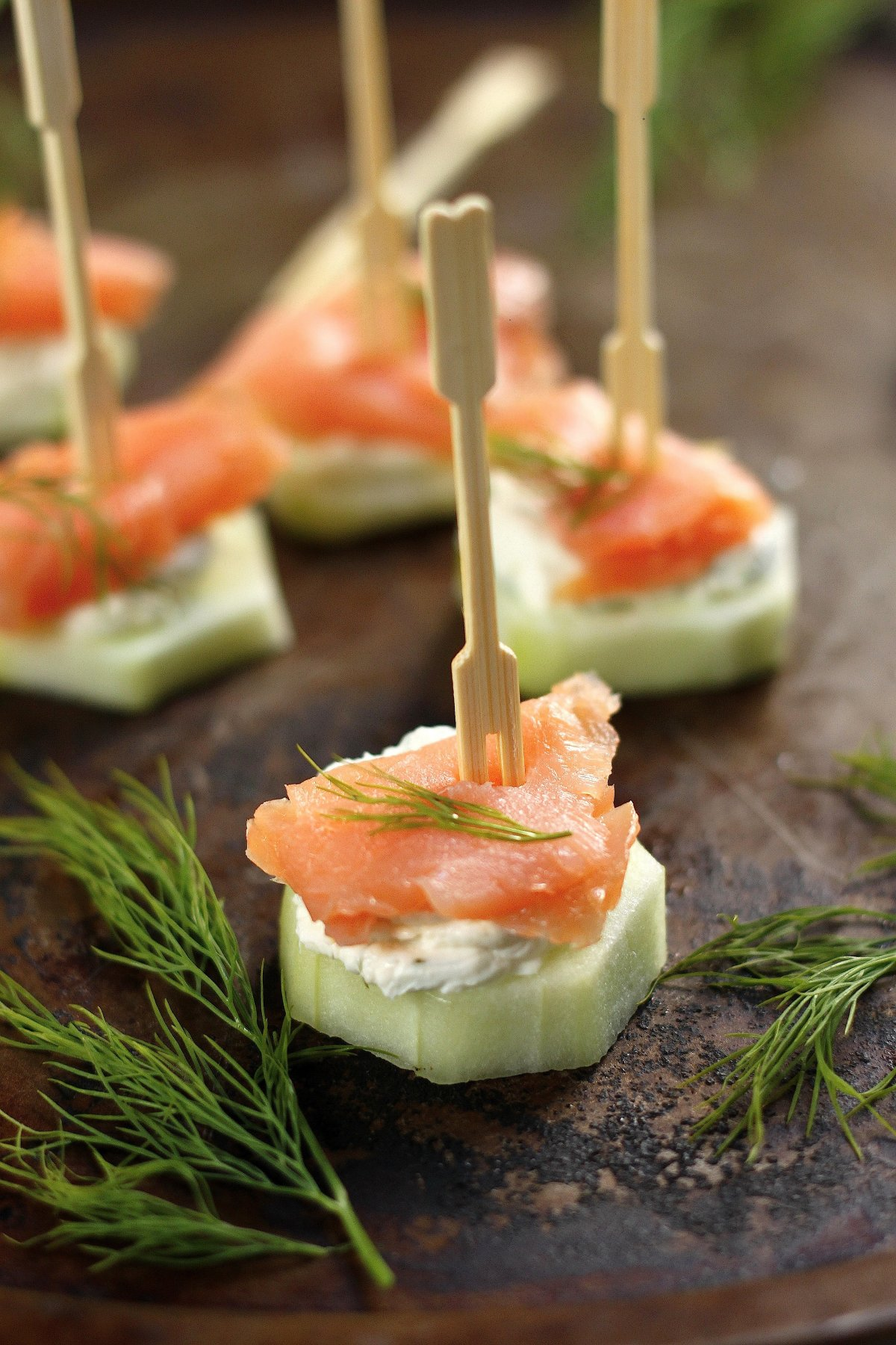 Smoked salmon and cream cheese cucumber bites baker by for Canape meaning in english