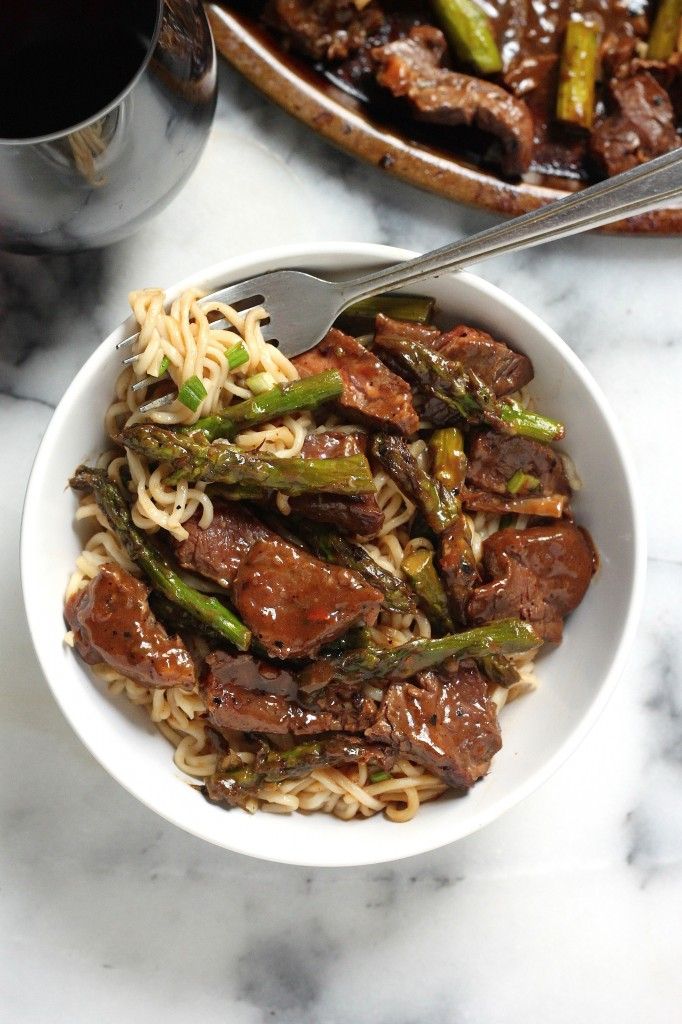 Steak and Asparagus Teriyaki Ramen Noodles in white bowl with fork.