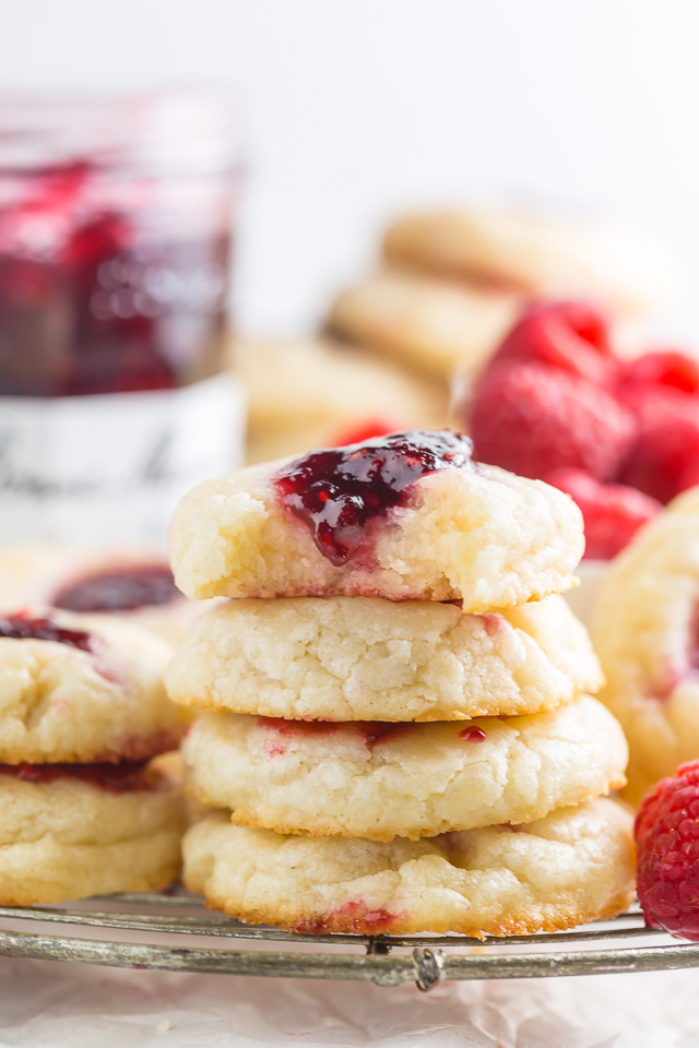 These 5-Ingredient Raspberry Cheesecake Thumbprint Cookies are so flavorful and basically melt in your mouth!!! An easy cookie recipe you'll make over and over again!