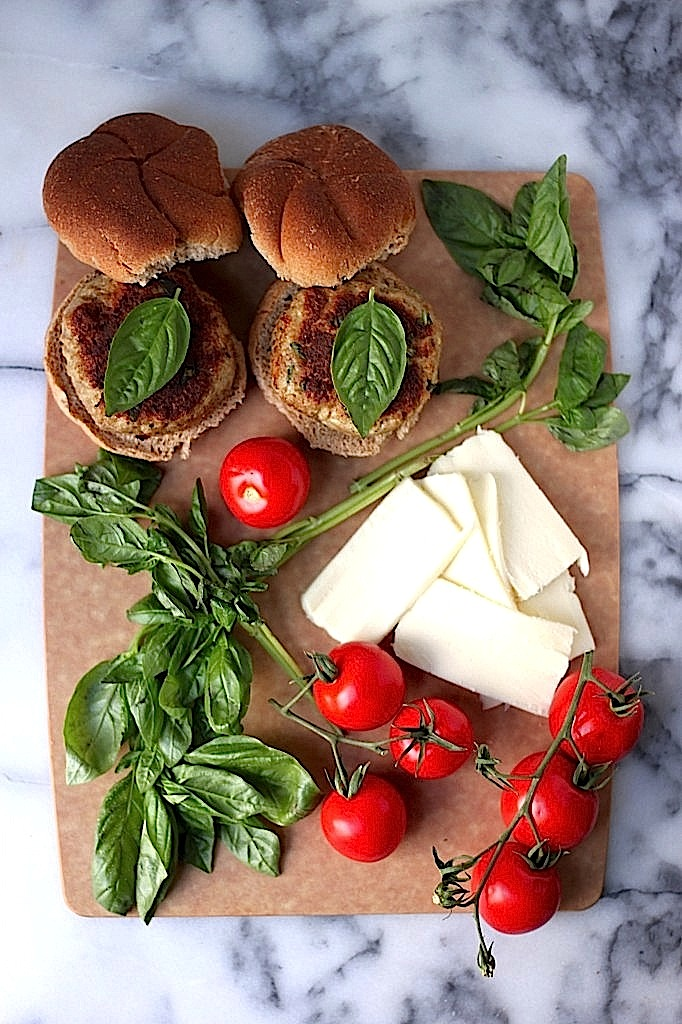 Juicy, flavorful chicken burgers are topped with gooey mozzarella, roasted tomatoes, and fresh basil! These are a hit with everyone :)