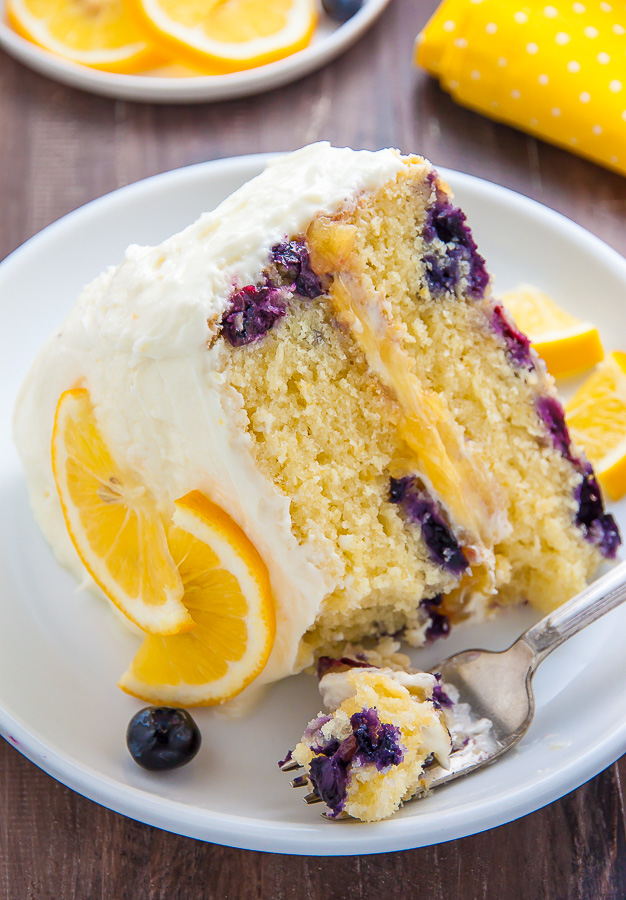 Supremely moist and flavorful Lemon Blueberry Cake slathered with homemade Lemon Frosting. This is the ULTIMATE Lemon Blueberry Cake!