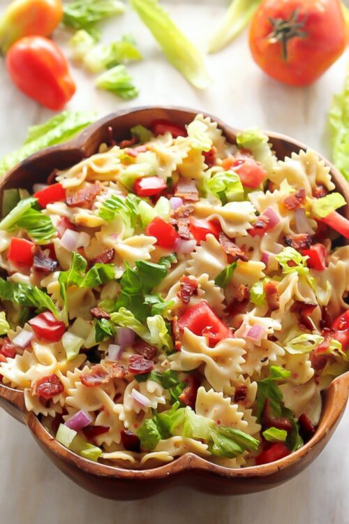 This 20-Minute BLT Easy Pasta Salad is fresh, fast, SUPER satisfying! This simple bow tie pasta salad is LOADED with bacon, lettuce, and tomato!!! And then it's dressed in a slightly creamy - and totally addicting - Zesty Italian dressing.