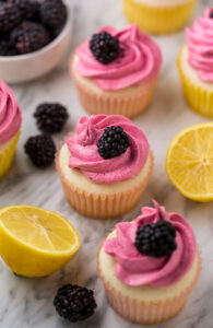 Fluffy Lemon Cupcakes are topped with BLACKBERRY Buttercream! These Lemon Blackberry Cupcakes are so pretty and always a showstopper. Their refreshing flavor makes them perfect for Spring and Summer celebrations!