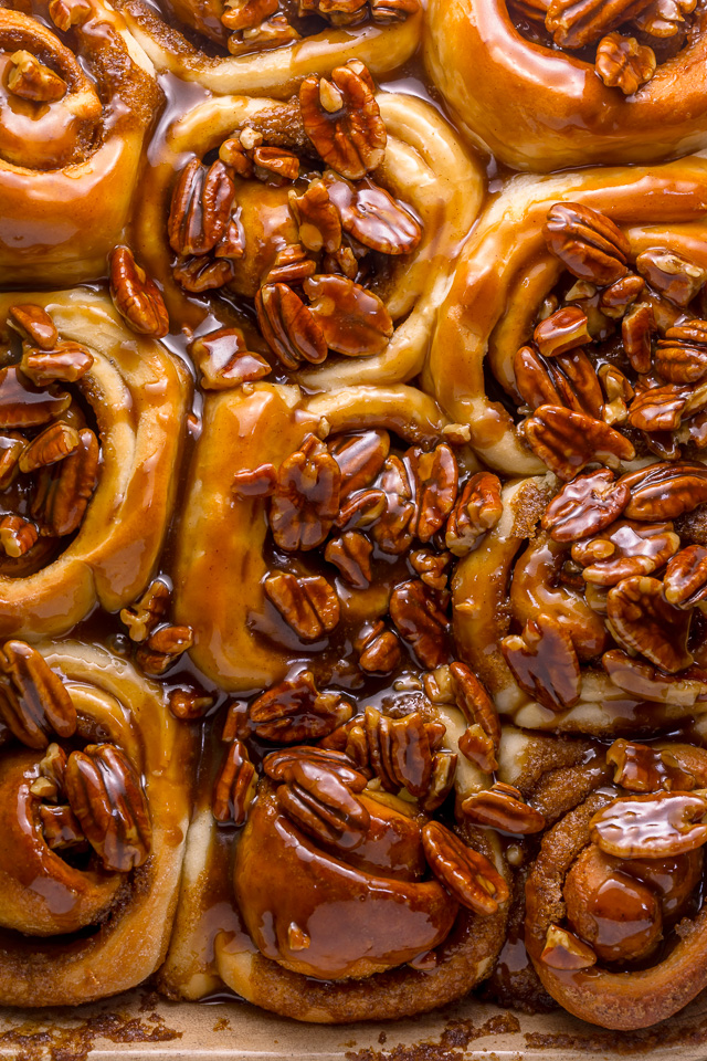 "We're butter pecan fanatics, so it only seems fitting that one of our favorite ""splurge"" breakfast treats are Butter Pecan Cinnamon Buns! They're just like classic cinnamon rolls, but with a TONS of crunchy, gooey, chopped pecans on top. Perfect for Thanksgiving or Christmas morning!"
