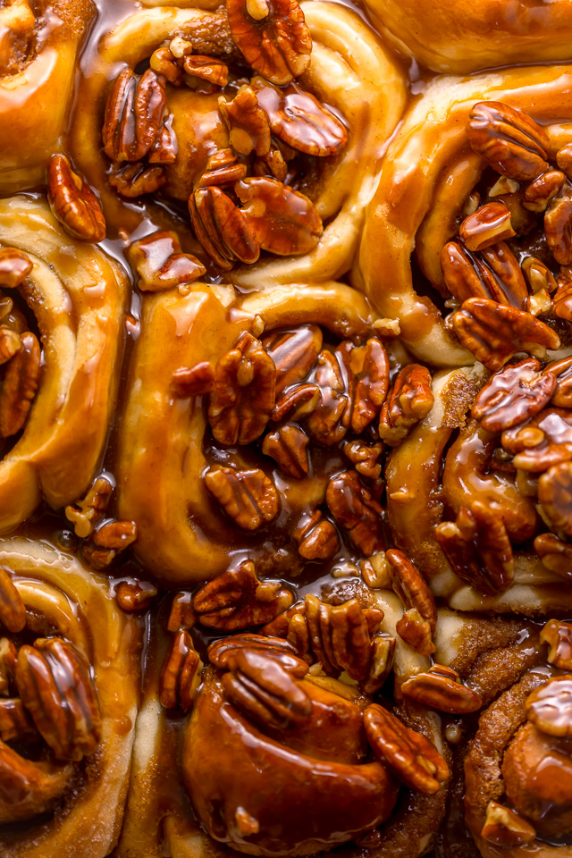"""We're butter pecan fanatics, so it only seems fitting that one of our favorite """"splurge"""" breakfast treats are Butter Pecan Cinnamon Buns! They're just like classic cinnamon rolls, but with a TONS of crunchy, gooey, chopped pecans on top. Perfect for Thanksgiving or Christmas morning!"""