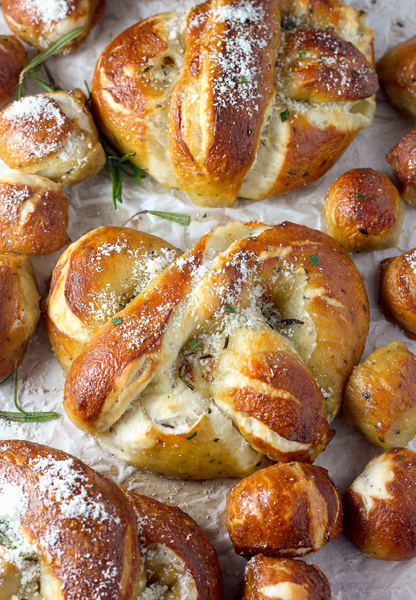 Mozzarella Stuffed Rosemary and Parmesan Soft Pretzels! Made with a simple soft pretzel dough and loaded with fresh herbs and Italian cheese. You're going to love these soft pretzels with cheese inside!