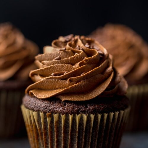 Homemade chocolate cupcakes are rich, moist, and come together in just one-bowl. Topped with a decadent chocolate buttercream - these cupcakes are as good as it gets!