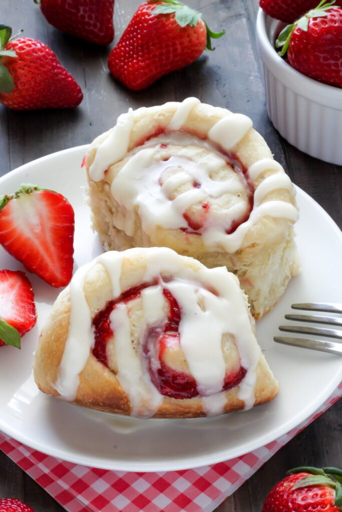 Strawberry Rolls with Vanilla Glaze - Soft, fluffy, and swirled with strawberry filling! The vanilla glaze is the perfect finish!
