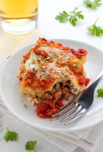 Lightened Up Chicken Parmesan Lasagna - layers of gooey cheese, chicken, sauce, and noodles! THIS IS AMAZING!