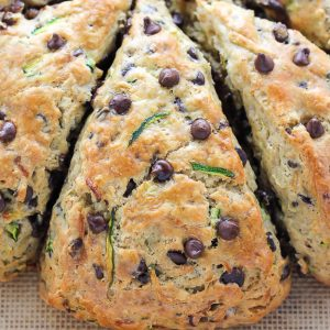 Chocolate Chip Zucchini Scones - Buttery Scones on baking pan.