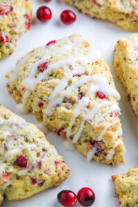 Homemade Cranberry Ricotta Scones feature supremely soft centers, crunchy tops, and a sweet orange glaze.