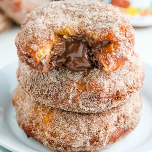 Homemade Cinnamon Sugar Doughnuts stuffed with a dollop of creamy Nutella. The definition of decadence!