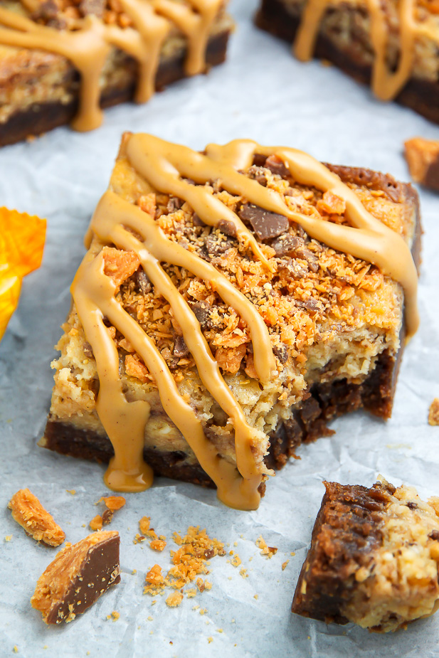 If the thought of Creamy Butterfinger Finger Cheesecake Brownies drizzled with peanut butter glaze makes you weak at the knees, this post is going to rock your life.