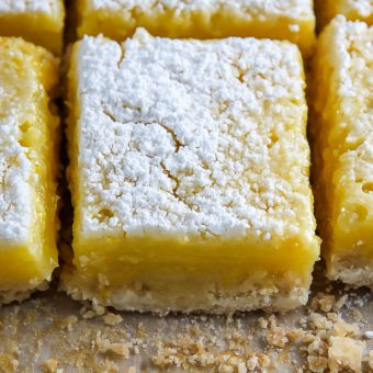 Sunny Lemon Squares feature a crunchy coconut crust, creamy lemon filling, and sprinkle of sweet sugar on top. YUM.