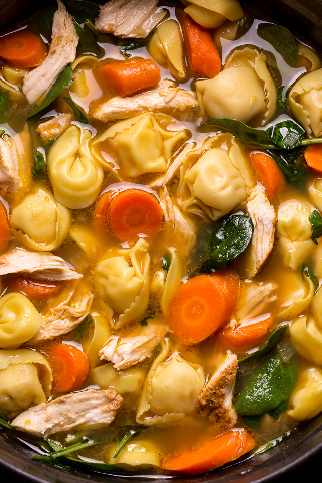 Nothing screams cozy like a giant bowl of Italian Chicken Tortellini Soup! Loaded with tender cheese tortellini, shredded chicken, fresh baby spinach, carrots, and celery... all in a super flavorful chicken broth! Serve this family favorite with extra parmesan cheese and crusty bread.