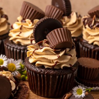 Have a peanut butter lover in your life? You have to bake them these Ultimate Chocolate Peanut Butter Cupcakes! Featuring moist chocolate cupcakes that are stuffed with a peanut butter cup, topped with peanut butter frosting, milk chocolate peanut butter ganache, and chopped peanuts, these are always a crowd-pleaser!
