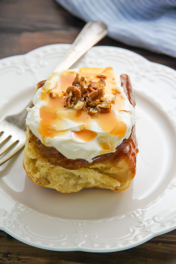 Soft and fluffy homemade cinnamon buns topped with salted caramel and cream cheese frosting!