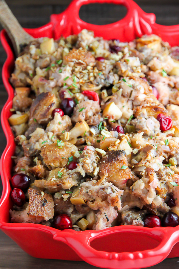 My go-to holiday stuffing recipe loaded with fresh herbs, chopped apples, cranberries, and sausage! Bonus: This recipe can be made ahead to help you save time.