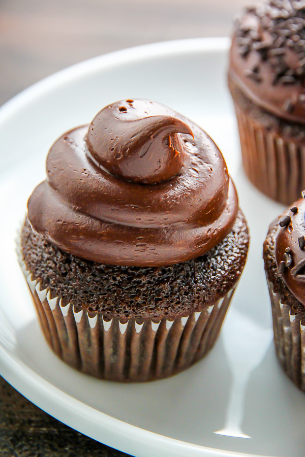 Old fashioned chocolate buttermilk cupcakes topped with a generous ...