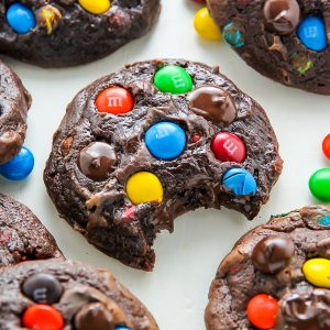 Thick and chewy soft batch chocolate cookies loaded with rainbow M&Ms and gooey chocolate chips!