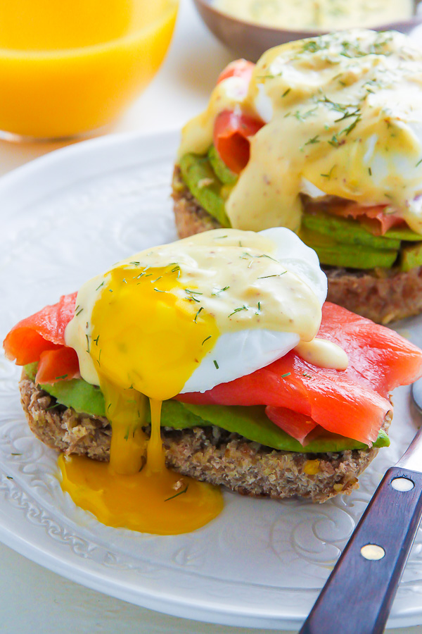 Smoked Salmon and Avocado Eggs Benedict with runny yolk.
