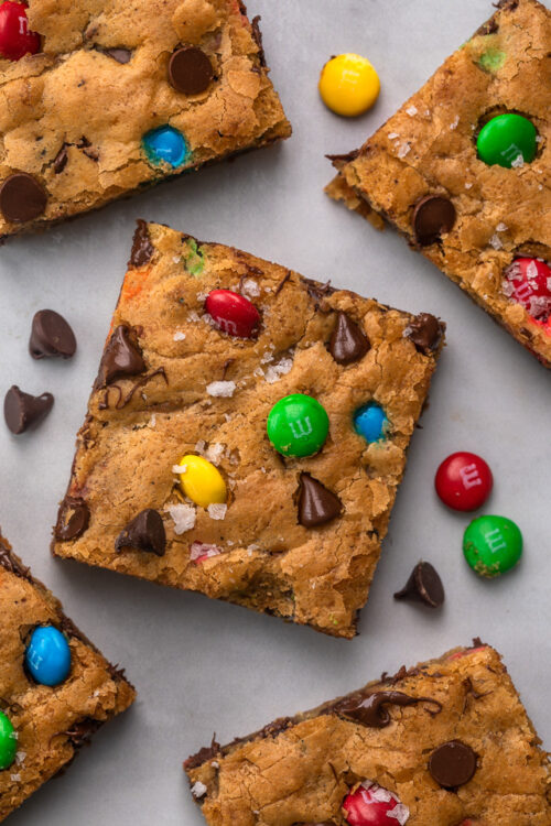 These thick and chewy Brown Butter M&M Blondies are irresistible! An easy cookie bar that's loaded with chocolate chips and M&M candies. Loved by kids and adults, this blondie recipe is always a crowd pleaser!