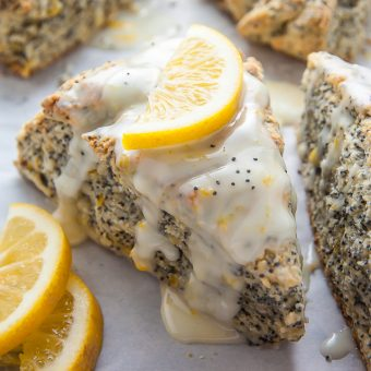 Classic and crumbly Meyer Lemon Poppy Seed Scones. The sunshine sweet lemon glaze makes them irresistible!