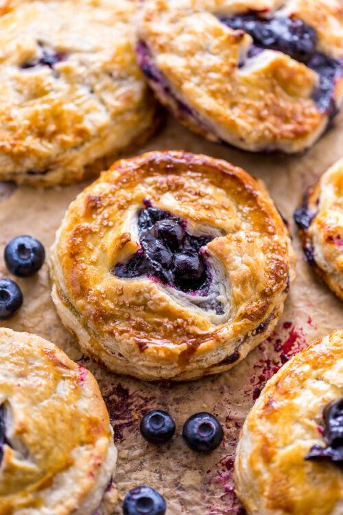 Mini Blueberry Pie on baking sheet.