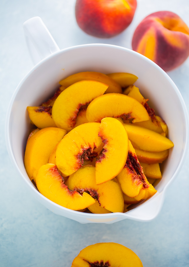 Sliced peaches for peach pie filling.