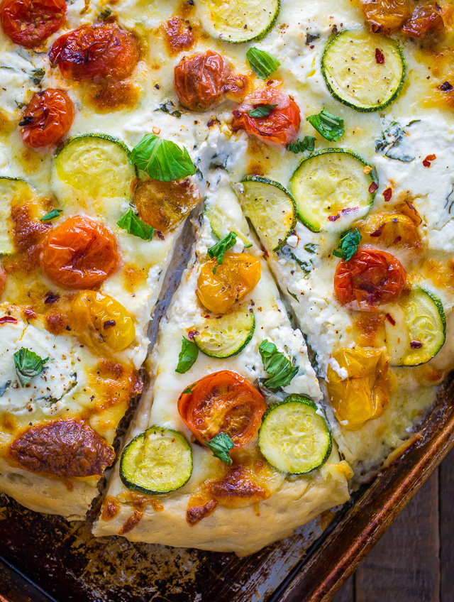 My favorite White Pizza with tomatoes, basil, and zucchini! AKA the PERFECT Summer meal.