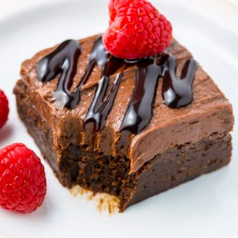 Raspberry Truffle Brownies feature a thick and chewy brownie base, chocolate raspberry frosting, and a chocolate drizzle!