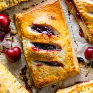 Homemade Cherry Hand Pies have flaky crust and juicy filling!