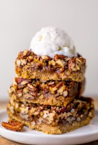 Thick and chewy Pecan Pie Bars! So good with a scoop of ice cream on top.