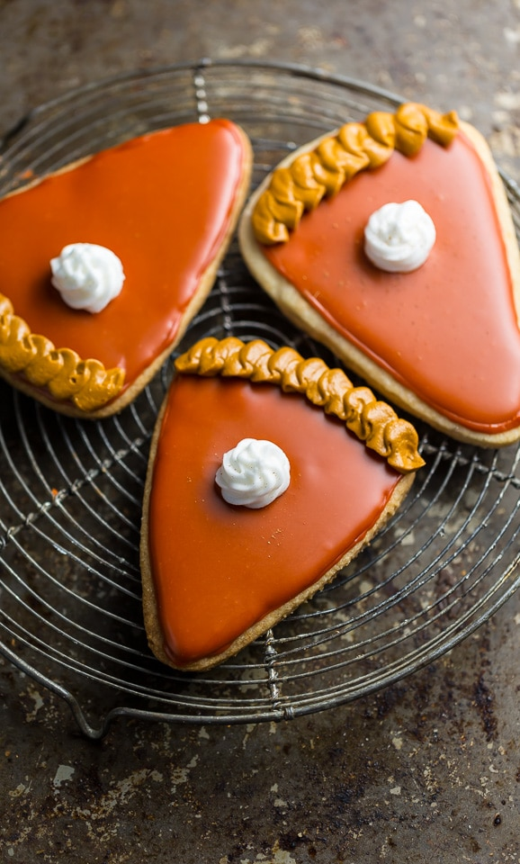 These Pumpkin Spice Cut-Out Cookies are dressed up to look like little slices of pumpkin pie! Does it get any cuter than this?