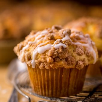 Bakery-Style Coffee Cake Muffins are moist, flavorful, and topped with plenty of buttery crumbs. This is one of those recipes you'll make over and over again!