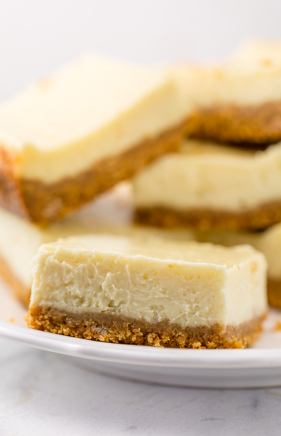 These New York-Style Cheesecake Bars are thick, creamy, and so easy! Perfect for almost any occasion!