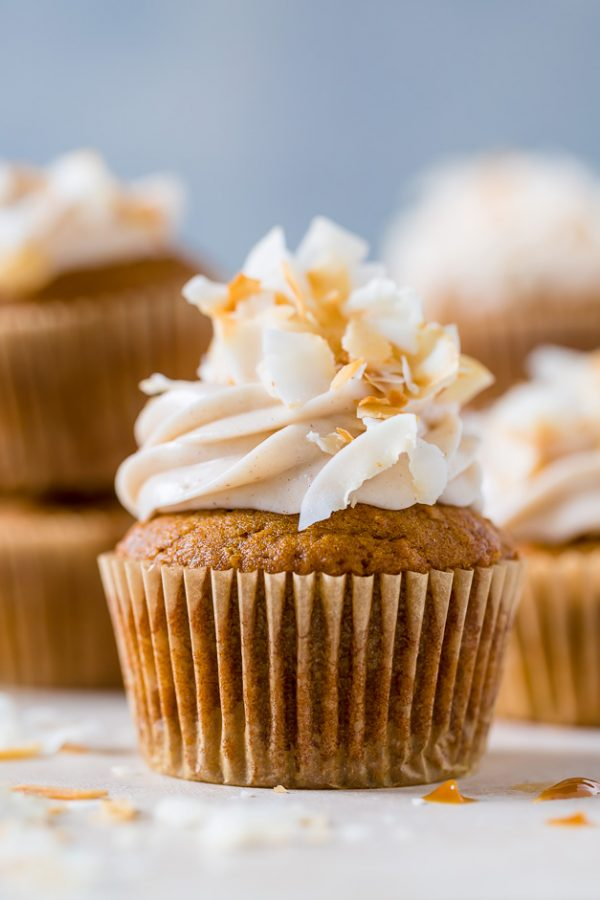 Moist and fluffy Pumpkin Coconut Cupcakes are stuffed with decadent Dulce de Ceche and covered in cinnamon cream cheese frosting! So delicious!
