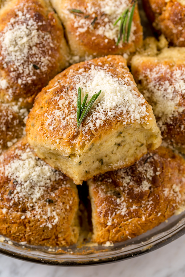 Rosemary Parmesan Biscuits are fluffy, flavorful, and so good with a bowl of soup or chili! Perfect for Thanksgiving, too!
