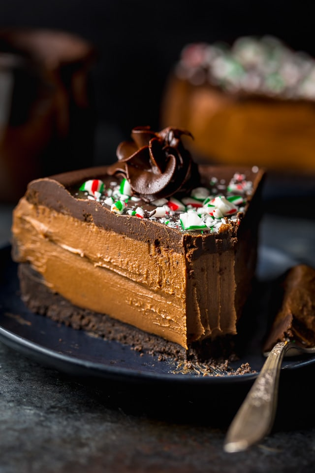 This No-Bake Peppermint Mocha Cheesecake is rich, creamy, and so flavorful! Topped with chocolate ganache and crushed candy canes, this chocolate peppermint cheesecake is seriously festive and perfect for holiday celebrations. #peppermintmocha #cheesecake #chocolate #Christmas #peppermint