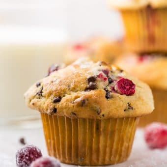 These soft and fluffy Cranberry Banana Muffins are so easy and perfect for breakfast! Full of real banana flavor, fresh cranberries, and a handful of chocolate chips, they're simply irresistible! #cranberry #banana #muffins #breakfast #Christmas #bananamuffins #chocolatechips